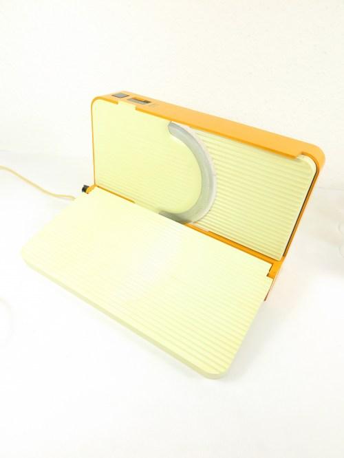 Bild 1 von 70er Brotschneide-maschine Orange Variotronik
